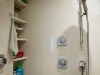 hanstone-quartz-clad-shower-walls-and-shelving-in-champagne-pearl